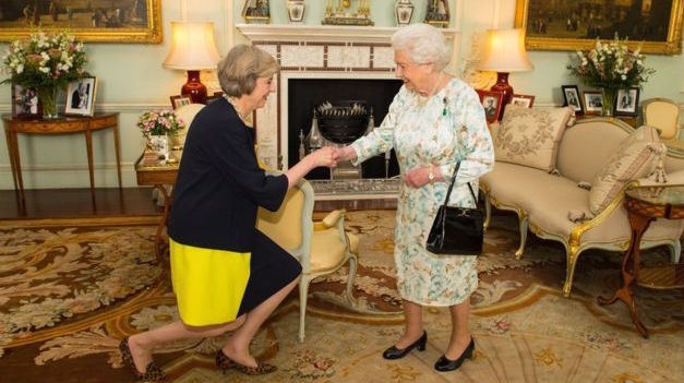 Two victims of the Collider meet in front of the world's biggest fireplace. The impact of the Collider has forced them to adopt strange positions, probably as a result of too much exposure to the chemical gas Neocon
